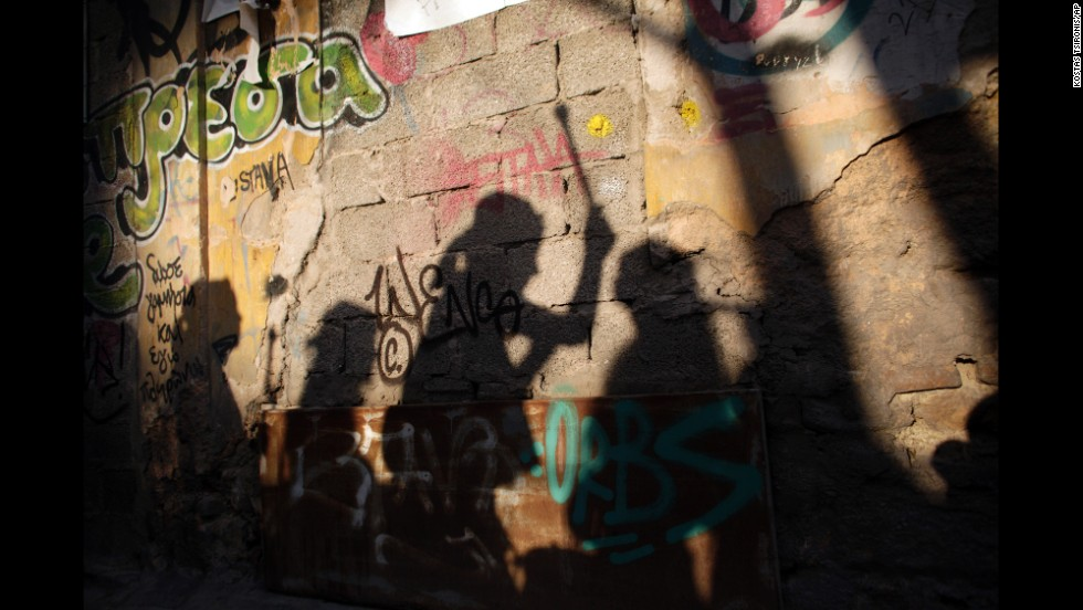 Shadows of musicians are cast against a wall during carnival celebrations in Athens, Greece, on February 23.