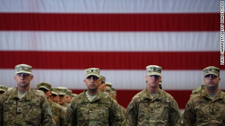 FORT KNOX, KY - NOVEMBER 20:  Soldiers from the U.S. Army's 3rd Brigade Combat Team, 1st Infantry Division, stand to attention while being introduced during a homecoming ceremony in the Natcher Physical Fitness Center on Fort Knox in the early morning hours of Wednesday, November 20, 2013 in Fort Knox, Ky. The 250 soldiers returned to Fort Knox after a nine-month combat deployment working alongside Afghan military and police forces in Afghanistan's Zabul Province. (Photo by Luke Sharrett/Getty Images)