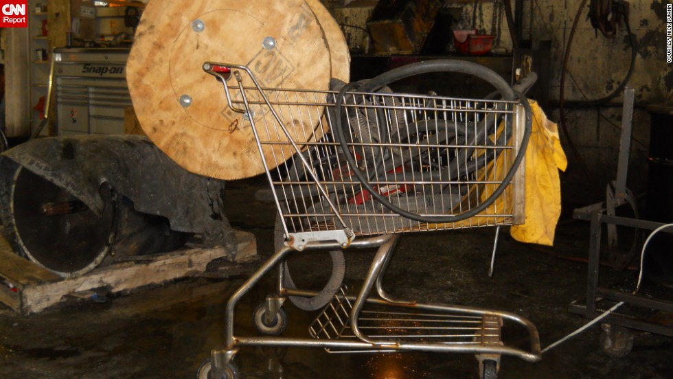 "A mechanic attached a <a href=""http://ireport.cnn.com/docs/DOC-1093315"">steam jenny hose</a> to a shopping cart that was kept in an old trucking terminal in Rochester, New York."