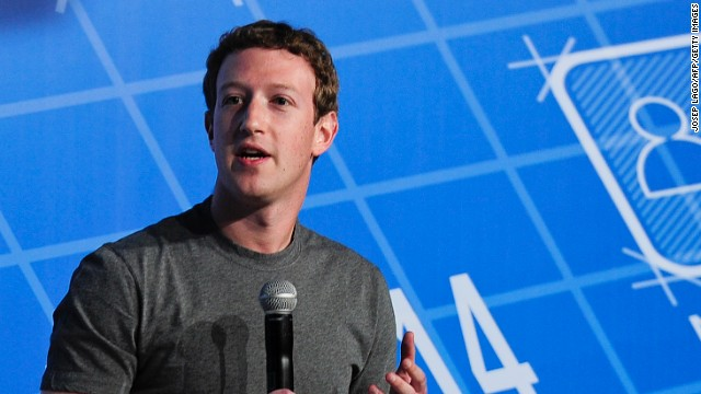 Facebook, 29-year-old billionaire founder and CEO Mark Zuckerberg (R) speaks on the opening day of the Mobile World Congress in Barcelona, on February 24, 2014.