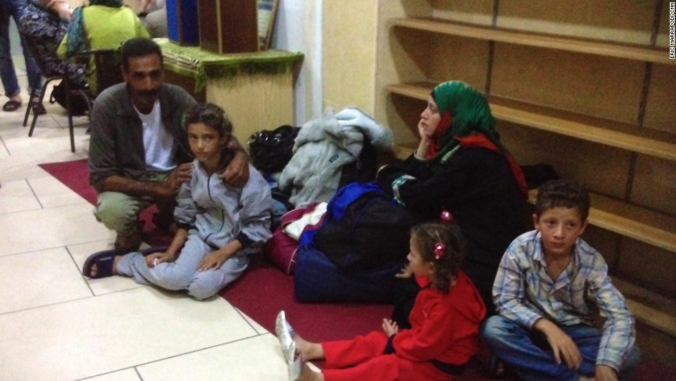 A Syrian family arrives at the mosque in Catania, Italy, on nearby Sicily.