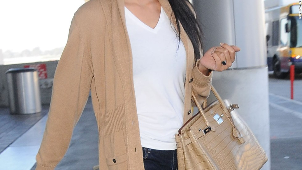 A newly married Kimora Lee Simmons arrives back in Los Angeles on February 21.