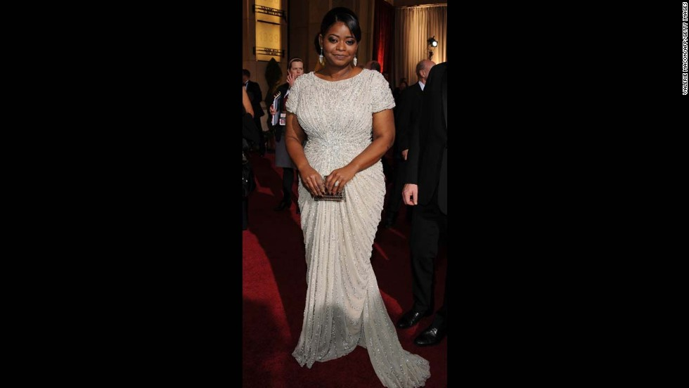 With her side-swept hair and curve-hugging column gown, Octavia Spencer was the very picture of classy glamour as she accepted the best supporting actress Oscar at the 2012 ceremony.