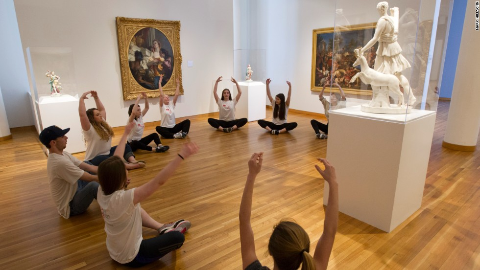 "Galloway teacher Sally Cramer leads a session called ""Art from Art"" for older Galloway students. The goal was to guide students toward a relationship with a piece of art in the museum and urge them to create their own original words and movements."
