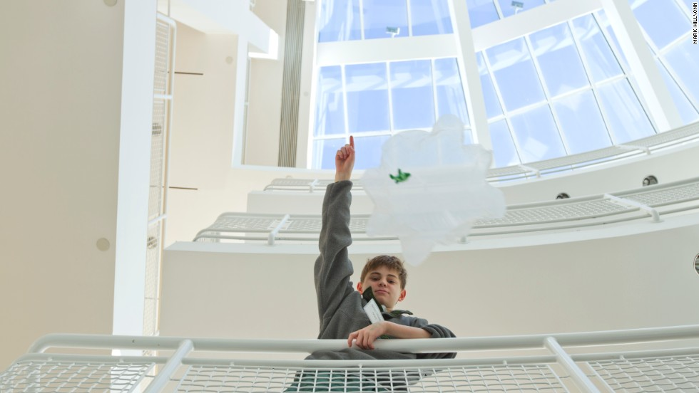 In February, 750 students from the Galloway School in Atlanta took over the High Museum of Art to try out different types of learning. Here, student Nolan Shields drops a parachute over a balcony inside the High Museum of Art. Students took advantage of thousands more square feet than their usual classrooms to test and learn about concepts in math and physics.