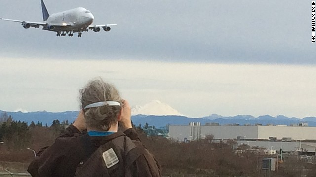 """We're gonna be late for breakfast,"" says Steve Dillo as he photographs Boeing's Dreamlifter. ""But this is worth it."""