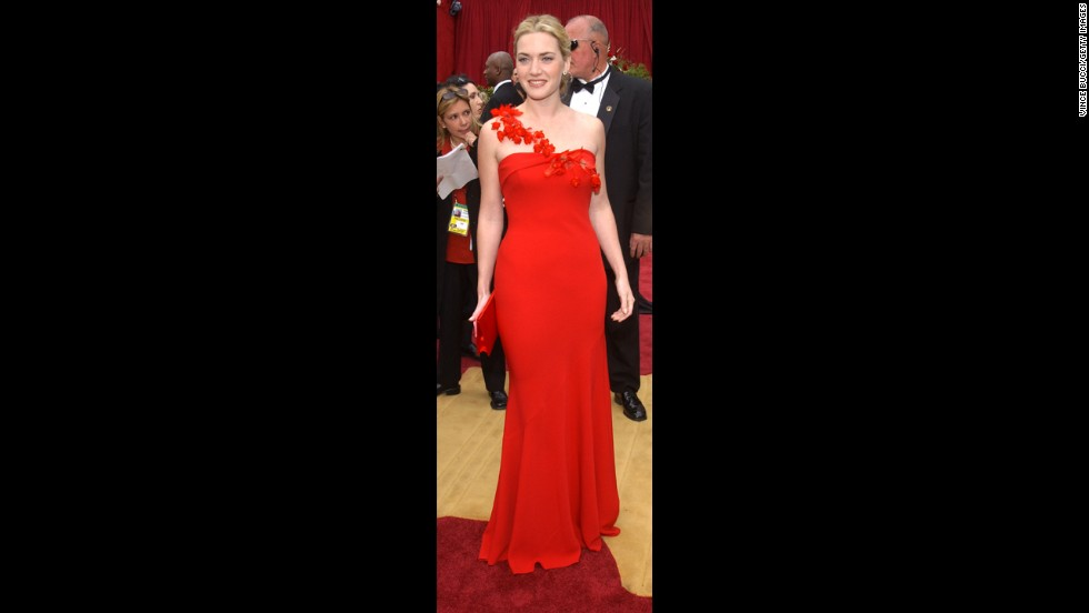 In 2002, Kate Winslet was no shrinking violet in a bright-red, form-fitting gown. But the delicate flowers that made up the strap helped soften and elevate the look.