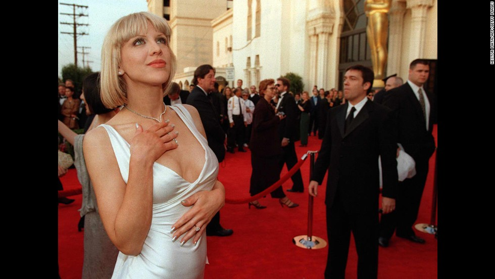 On the opposite end of the dress spectrum in 1997 was Courtney Love, who caused double-takes up and down the red carpet as she walked in a classy, alluring white satin Versace gown.