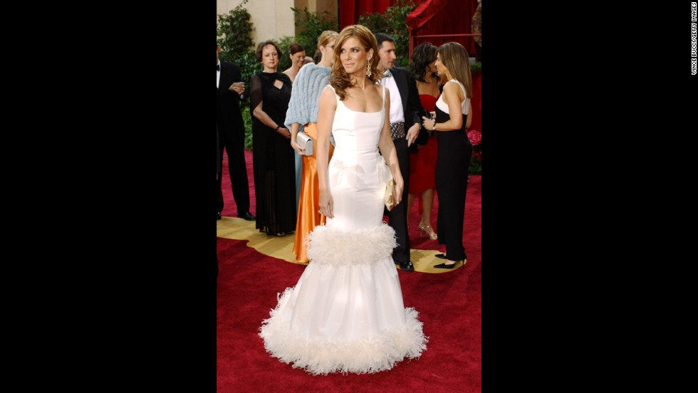 We love Sandra Bullock to bits, but we don't love all the extraneous parts on her 2004 Oscars dress. Did it really need to be tiered and feathered and have bows?