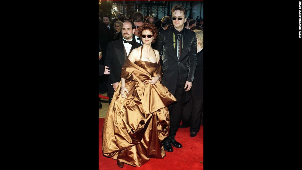 "As though satin formalwear isn't already difficult enough to pull off, Susan Sarandon went and had her Dolce & Gabbana dress made in an awkward copper shade to match her hair in 1996. Not that our opinion matters for much: Sarandon won the best actress Oscar that year for ""Dead Man Walking,"" and the dress was donated to the Metropolitan Museum of Art's Costume Institute."