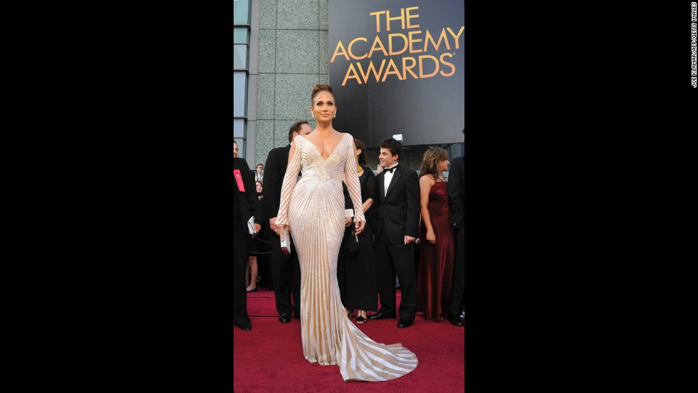 We didn't mind Jennifer Lopez's sleek, form-fitting gown at the 2012 Oscars all that much ... until we realized that it was cut so low it was a wardrobe malfunction waiting to happen.