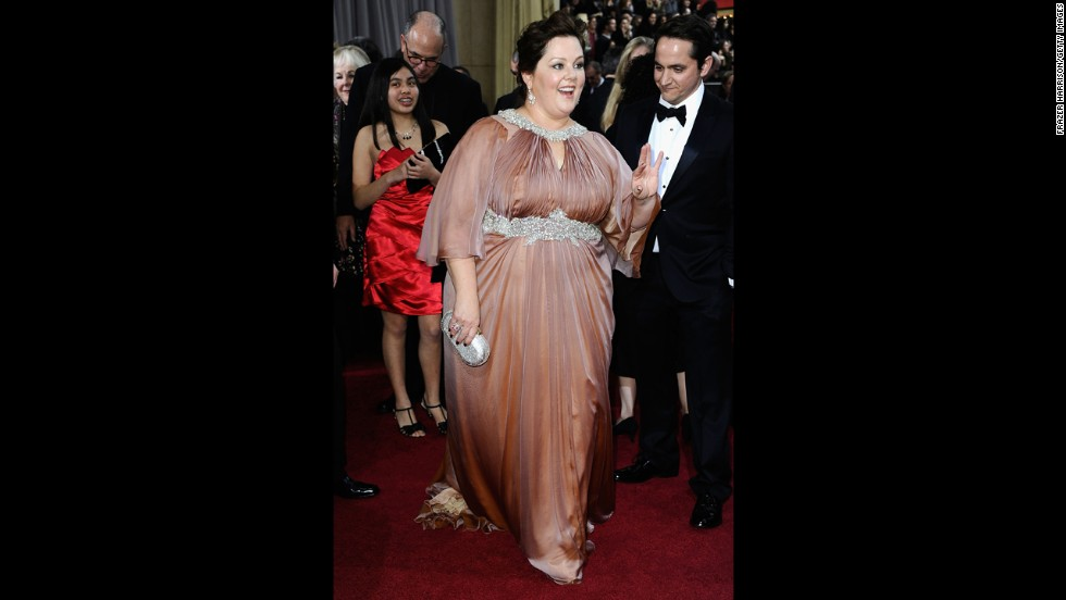 We love Melissa McCarthy so much that we've pre-emptively pledged to see each and every one of her movies, including the poorly reviewed ones. That is why it pained us to see her wear this awkward dress to the 2012 Oscars.
