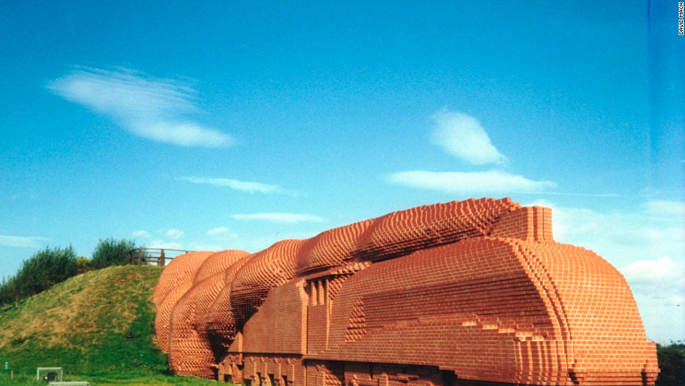 In 1997 he made a train out of 185,000 bricks, weighing 15,000 tons, coming out of a hillside near the northern English town of Darlington.