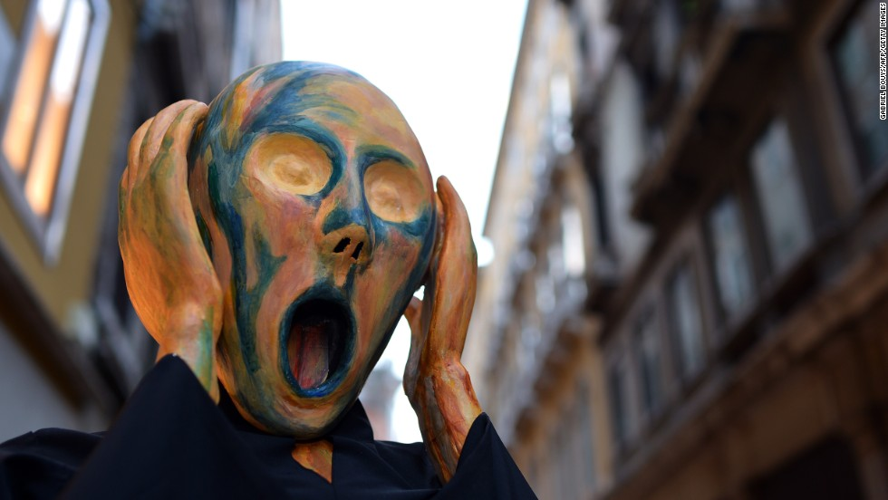 "Masks like the <em>volto</em> can be a source of anxiety, an idea which this reveler plays on with his Munch-inspired costume. Popular culture teaches us to fear people with masks. Just think of Hannibal in ""Silence of the Lambs"" and Jason in ""Friday the 13th""."
