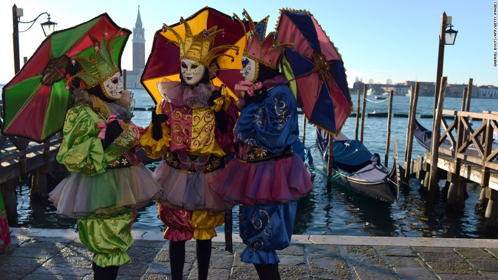 "Every year up to three million visitors swarm the <a href=""http://www.carnevale.venezia.it/?slang=en"" target=""_blank"">Carnival of Venice</a>, a giant masquerade party that lasts for more than two weeks. Revelers mingle at cultural events and let loose at riotous street parties. No costume is complete without a mask or, in this instance, a court jester's parasol."