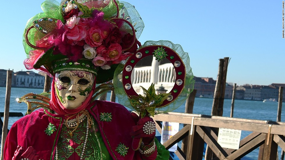"Of course it's not all fear and anxiety. <a href=""http://www.carlaalmanza-dequant.com/index.htm"" target=""_blank"">Carla Almanza-de Quant</a>, an artist and Venetian mask maker in California, says that masks actually un-mask the person inside of us. ""Once you put on a mask you're cheerful, you're playful, you're a more wonderful you,"" she says. ""You become a fantasy character and you interact with others in a more outgoing way."""