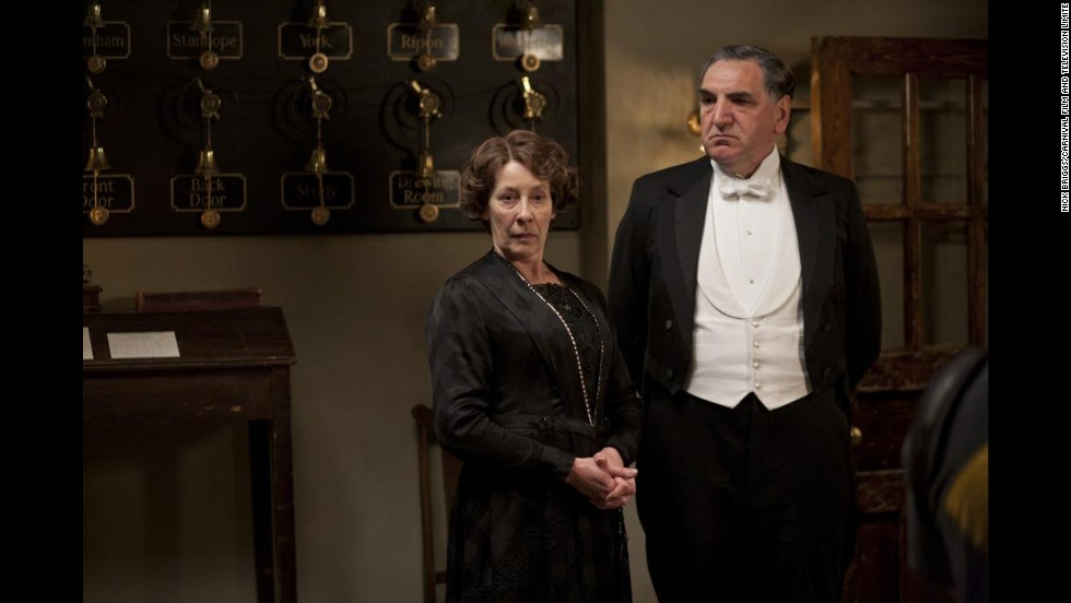 Carson wears a white waist coat and a white tie similar to those worn by Lord Grantham. Differentiating the butler from the gentlemen was all about the quality of the cloth and tailoring, said Jeff Groff, one of the exhibition curators. Mrs. Hughes' silhouettes are similar to those worn by the Dowager Countess but much plainer and simpler.