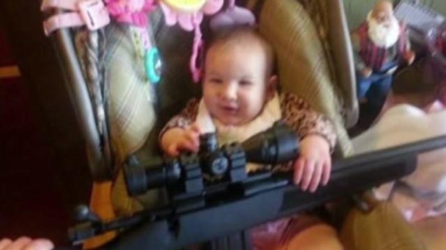 dnt ct imiage of baby holding gun_00000523.jpg