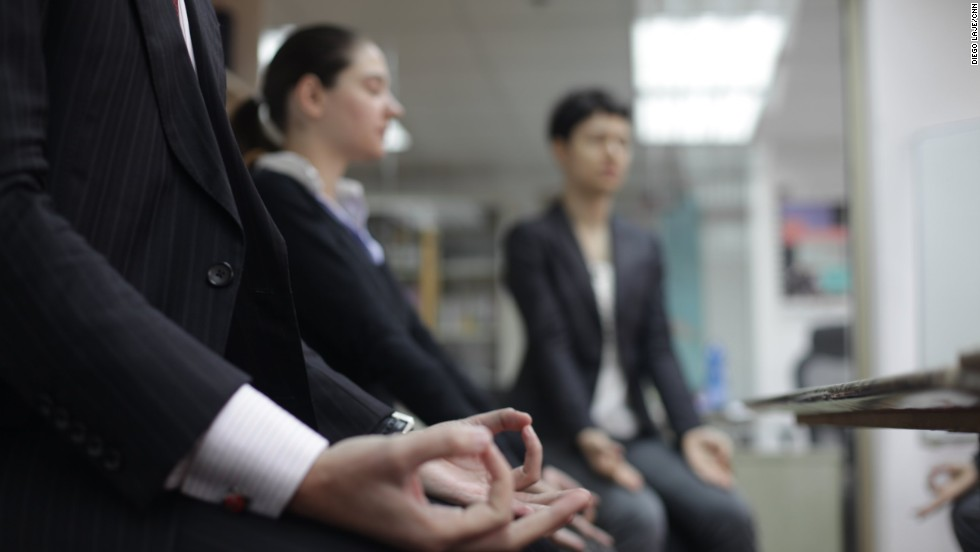 Bosetti and his colleagues practice yoga at the office of the Italian Chamber of Commerce in Hong Kong and Macao.