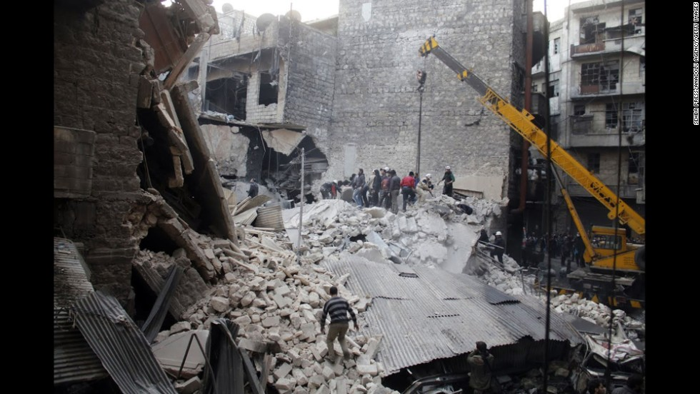 People dig through the rubble of a building in Damascus that was allegedly hit by government airstrikes on Thursday, February 27.