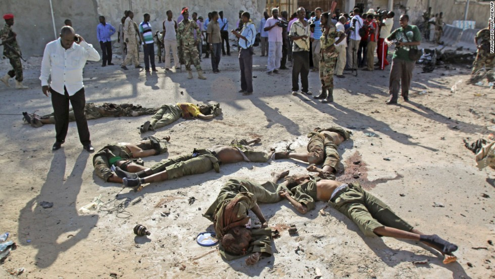 "Dead bodies of militants are seen on the ground after they carried out <a href=""http://www.cnn.com/2014/02/21/world/africa/somalia-attack/index.html"">an attack on Somalia's presidential palace</a> Friday, February 21, officials and eyewitnesses said. Terror network Al-Shabaab, al Qaeda's affiliate in Somalia, claimed responsibility for the attack that killed at least 12 people, seven of them militants, Somalia's national security minister said."