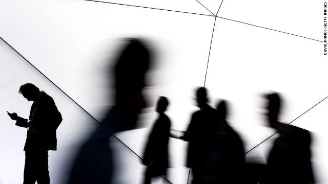 Visitors walk past a Samsung stand during the first day of the Mobile World Congress 2013 at the Fira Gran Via complex on February 24, 2014 in Barcelona, Spain.