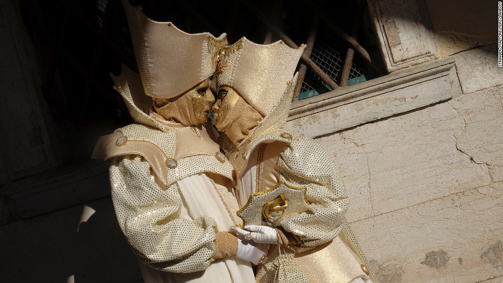 "Masked revelers pose during the Venetian Carnival in Venice, Italy, on Sunday, February 23. <a href=""http://www.cnn.com/2014/02/18/travel/most-colorful-carnivals/index.html"">Colorful carnival celebrations</a> are under way in cities around the world."