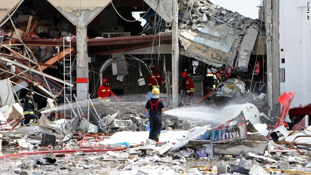 Firemen work at the site of an explosion in Doha, Qatar on February  27, 2014.