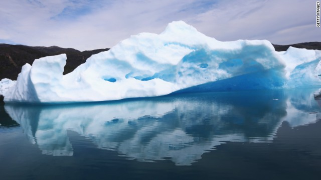 Calved icebergs from the nearby Twin Glaciers are seen floating on the water on July 30, 2013, in Qaqortoq, Greenland.