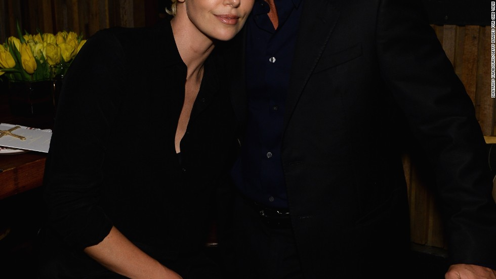 Charlize Theron and Sean Penn appear to confirm their rumored relationship as they cozy up at an event honoring Pharrell Williams on February 27.