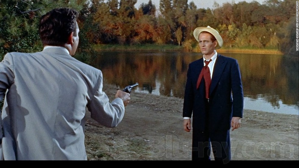 "Anthony Franciosa pulls a gun on Paul Newman in the 1958 classic ""The Long, Hot Summer."""