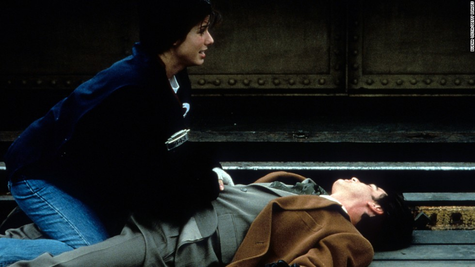 """Sandra Bullock and Peter Gallagher star in 1995's """"While You Were Sleeping."""""""
