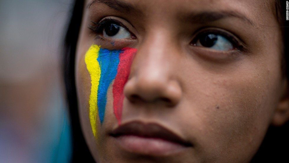 A demonstrator attends a rally with human rights activists in Caracas on Friday, February 28.