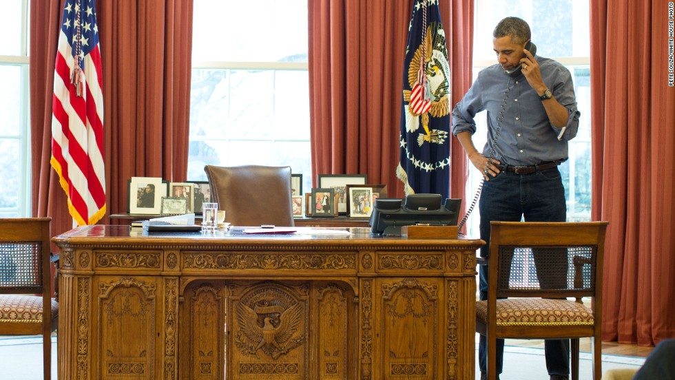 U.S. President Barack Obama, in the Oval Office of the White House, talks on the phone March 1 with Russian President Vladimir Putin.