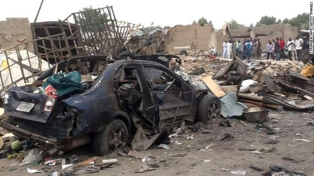 People gather Sunday near the scene of two explosions in Maiduguri, Nigeria.