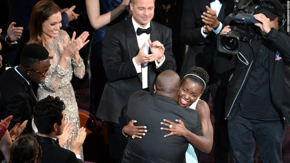 "Nyong'o hugs ""12 Years a Slave"" director Steve McQueen after winning the best supporting actress Oscar."