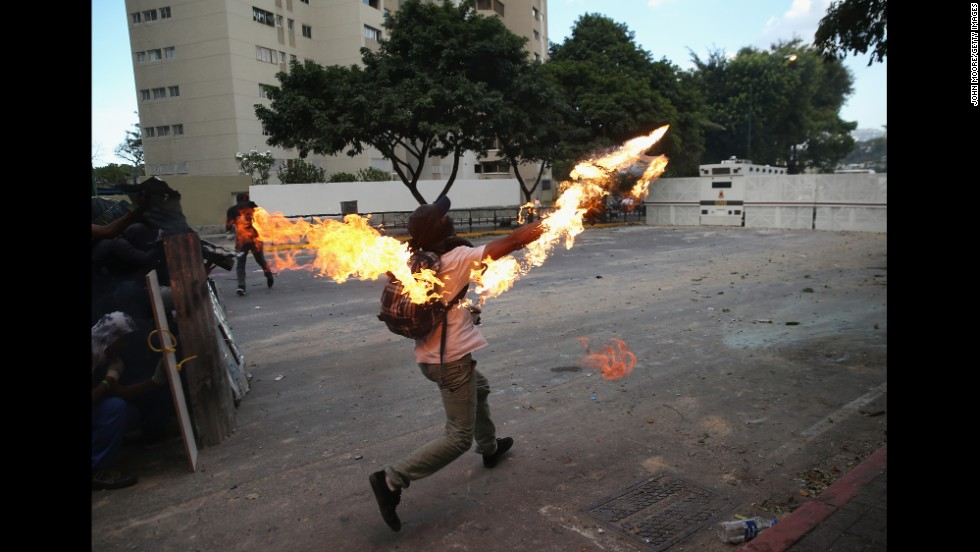 A protester hurls a Molotov cocktail at National Guard troops on March 2.
