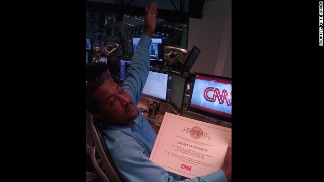 Mungin shows off his Peabody Award certificate for CNN's coverage of the Gulf oil spill in 2009.