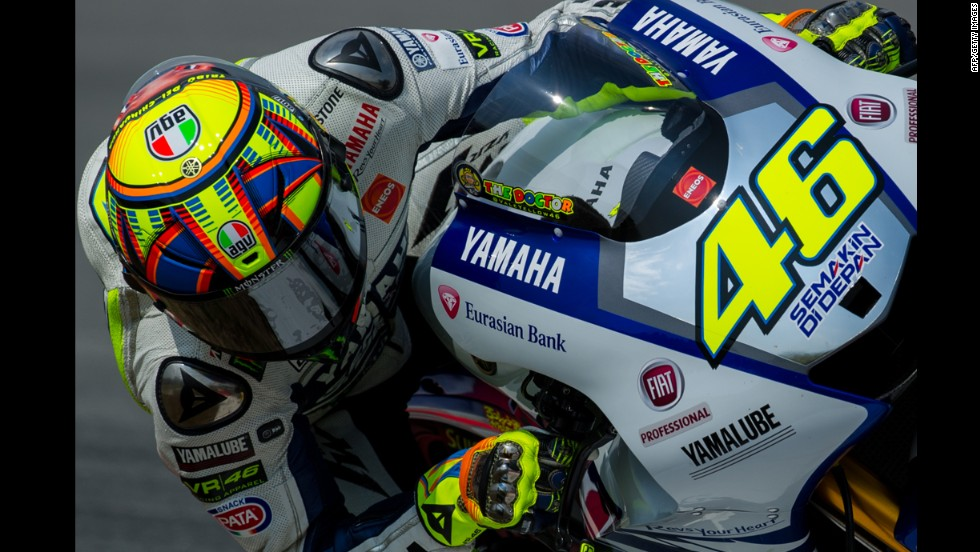 Motorcycle racer Valentino Rossi steers his bike during a MotoGP preseason test in Kuala Lumpur, Malaysia, on Thursday, February 27.