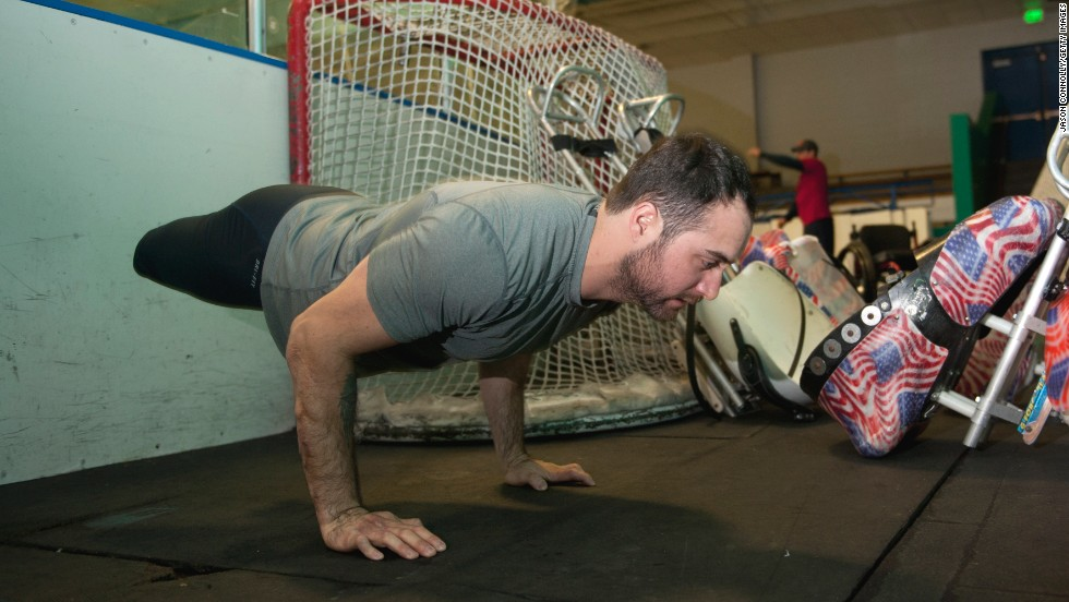 Josh Sweeney, a member of the U.S. Paralympic sled hockey team, does pushups prior to the team's final U.S.-based practice Thursday, February 27, in Colorado Springs, Colorado. The team is set to compete at the Paralympic Games in Sochi, Russia.