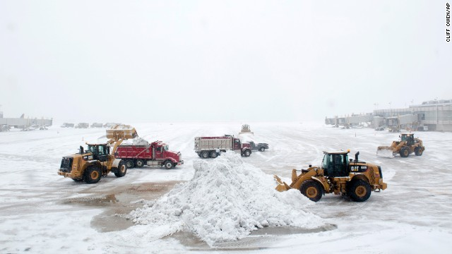Airport workers clear snow from the tarmac at Ronald Reagan Washington National Airport on Monday, March 3.