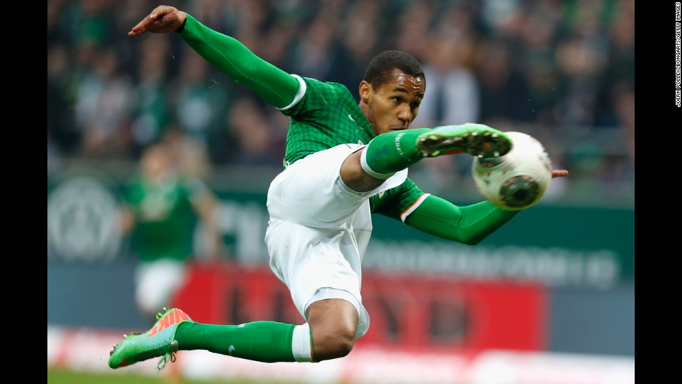 Theodor Gebre Selassie leaps to kick the ball during a Bundesliga match between Werder Bremen and Hamburger SV on Saturday, March 1, in Bremen, Germany.