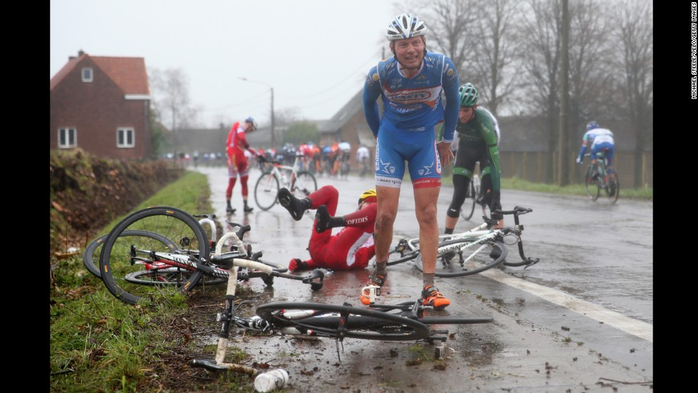 Laurens De Vreese, foreground, recovers after a crash during the Omloop Het Nieuwsblad in Ghent, Belgium, on Saturday, March 1.