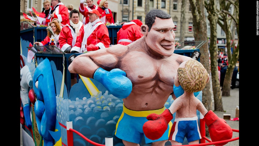 At a parade in Cologne, Germany, figures depict Vitali Klitschko, the Ukrainian opposition leader and former heavyweight boxing champion, fighting Russian President Vladimir Putin on March 3.