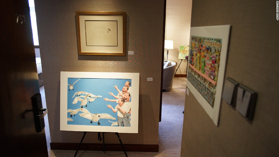 "Yue Minjun's ""Big Swan"" oil painting greeted visitors in room 751 at the Marco Polo Hongkong Hotel. Above the contemporary work is an original sketch by Pablo Picasso."