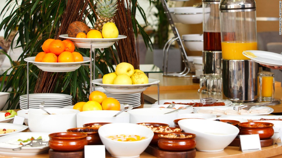 """<strong>Take a lap before serving yourself </strong><br /><br />In a Cornell University study published in the journal PLoS One, researchers observed people at two separate breakfast buffet lines that featured the same seven items: cheesy eggs, potatoes, bacon, cinnamon rolls, low-fat granola, low-fat yogurt, and fruit. One line presented the foods from healthiest to least-healthy, while the other line had the order reversed. <br /><br />Regardless of which line they passed through, more than 75% of diners put the first food they saw on their plates; the first three foods they encountered in the buffet made up two-thirds of all the foods they added to their plate. So take a stroll around the buffet or dinner table before you serve yourself, suggests Young.<br /> <br /><a href=""""http://www.health.com/health/gallery/0,,20676415,00.html"""" target=""""_blank"""">Health.com: 20 best foods to eat for breakfast </a>"""