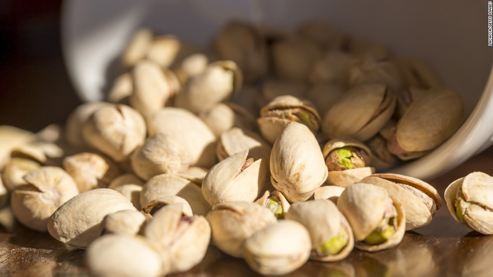 """<strong>Work for your food </strong><br /><br />Here's another way to slow down your eating: munch on foods that require shelling, peeling, or individual unwrapping, suggests Blatner. Oranges, edamame, and pistachios in their shells are healthy options. <br /><br /><a href=""""http://www.health.com/health/gallery/0,,20516496,00.html"""" target=""""_blank"""">Health.com: How to lose 12 pounds in a month </a><br />"""