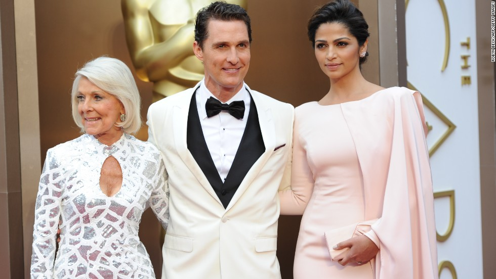"Winner for Best Actor in ""Dallas Buyers Club"" Matthew McConaughey with his mother, Mary Kathlene McCabe, left, and wife Camila Alves arrives on the red carpet for the 86th Academy Awards on March 2, 2014, in Hollywood, California."
