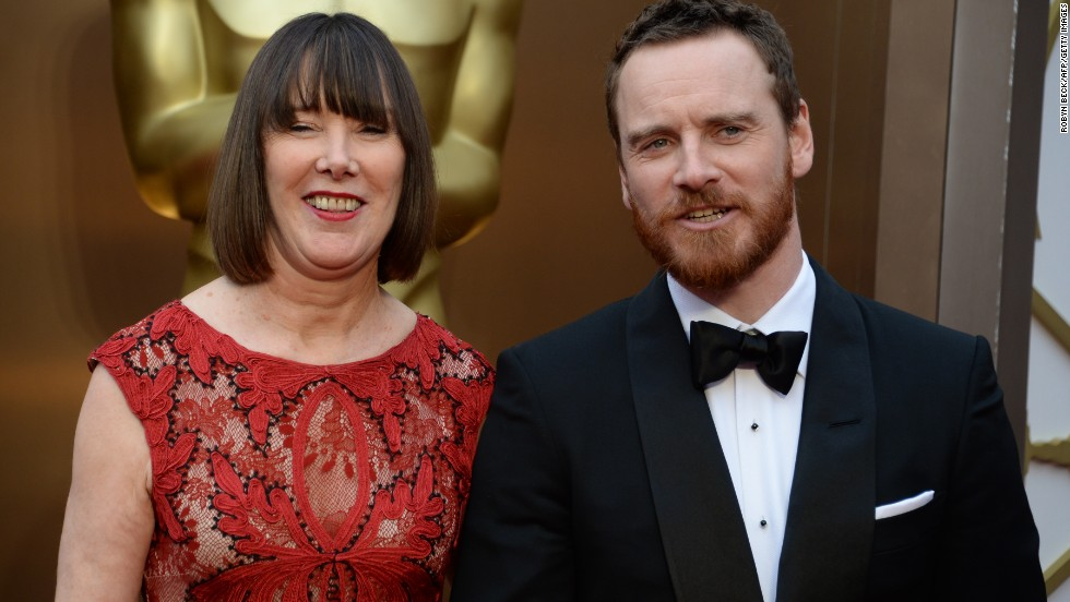 "Nominee for Best Actor in a Supporting Role for ""12 Years a Slave"" Michael Fassbender and his mother Adele arrive on the red carpet for the 86th Academy Awards."