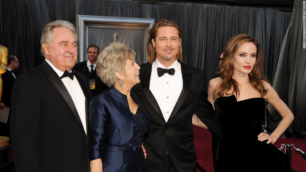 Brad Pitt is accompanied by his father William Alvin Pitt, left, mother Jane Pitt, second from left, and partner Angelina Jolie at the 84th Annual Academy Awards on February 26, 2012, in Hollywood, California.